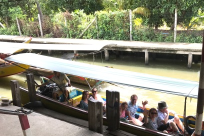 we took longboats to the floating markets